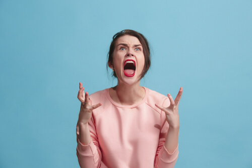 Screaming Female On A Blue Background